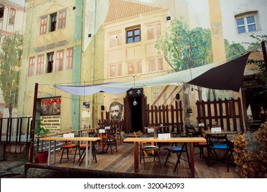 BELGRADE, SERBIA - SEP 13: Murals on the empty old cafe walls of the famous vintage street Skadarlija on September 13, 2015. Tourism in Serbia employs 75,000 people, about 3% of country's workers