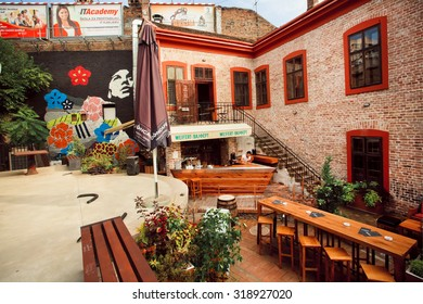 BELGRADE, SERBIA - SEP 14: Wooden furniture on the terrace of club on the background of brick walls on September 14, 2015. Tourism in Serbia employs 75,000 people, about 3% of the country's workers