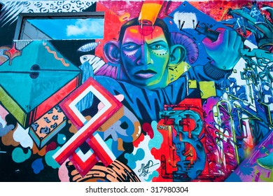 BELGRADE, SERBIA - SEP 15: Graffiti artwork with colorful patterns and african man face on the wall surface on September 15, 2015. Serbian capital - Beograd - has a population of 1.23 million people