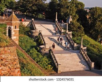 BELGRADE, SERBIA - SEPTEMBER 08, 2016. Sava Promedade and Great Stairs of Kalemegdan Park. People walk through the beautiful afternoon sun.