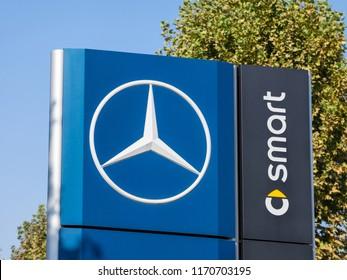 BELGRADE, SERBIA - SEPTEMBER 1, 2018: Mercedes Benz logo on their main dealership store Belgrade. Part of Daimler Group, Mercedes Benz is a German car manufacturer, specialized in luxury vehicles