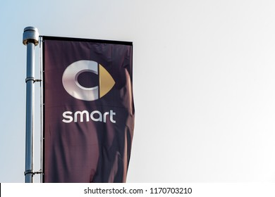 BELGRADE, SERBIA - SEPTEMBER 1, 2018: Logo of Smart on a flag in front of its dealership for Belgrade. Part of Daimler Benz Group, Smart is a brand of microcars