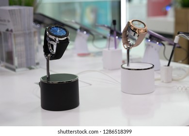 Belgrade, Serbia - September 13, 2018: Samsung Galaxy Watch 46 mm - SM-R800 and 42 mm - SM-R810 are displayed in electronic store. Two gadgets, silver one and gold rose, showing time on the screen.
