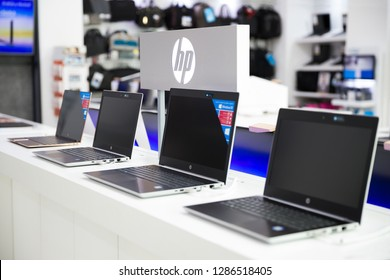 Belgrade, Serbia - September 13, 2018: New HP laptop computers are shown on retail display in electronic store.