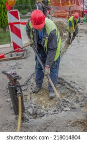 BELGRADE, SERBIA - SEPTEMBER 17:  Use pickaxe and shovel to dig trench for a new telephone and electricity cable. Selective focus and motion blur. At street Vojvode Stepe in September 2014.