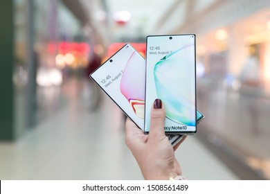 Belgrade, Serbia - September 18, 2019: New Samsung Galaxy Note 10 and Note 10+ mobile smartphones are displayed in hand on isolated blurry background.