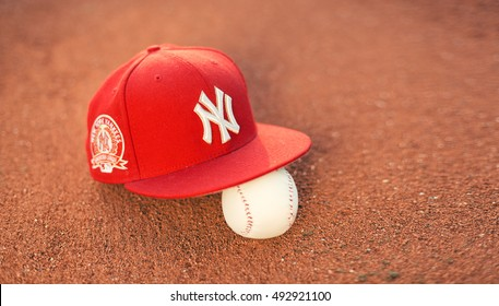 BELGRADE, SERBIA - SEPTEMBER 2, 2016: New York Yankees cap on pitchers mound. Yankees are one of the most famous baseball teams in the world.
