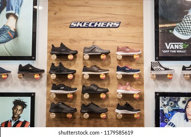 BELGRADE, SERBIA - SEPTEMBER 2, 2018: Skechers logo and sneakers on display in the window of their main retailer in Belgrade. Skechers is an American lifestyle and performance footwear company