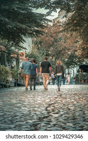 BELGRADE SERBIA, SEPTEMBER 2017: Skadarlija street, popular tourist attraction ,old Belgrade. Filled with restaurants and coffee shops. Tourists passing by, walking on the cobblestone.
