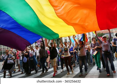 BELGRADE, SERBIA - SEPTEMBER 20:People hold a huge rainbow flag at Gay Pride parade 2015 in Belgrade
