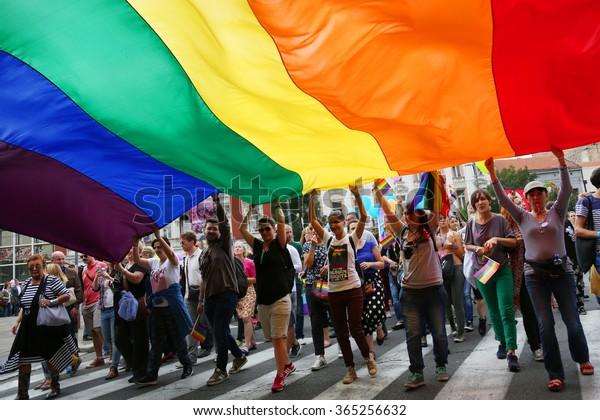 BELGRADE, SERBIA - SEPTEMBER 20:People hold a huge rainbow flag at Gay Pride parade 2015 in Belgrade