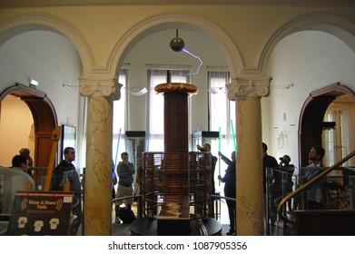 BELGRADE, SERBIA - SEPTEMBER 27, 2013. Visitors are making an experiment with the  High-frequency Oscillator in the Nikola Tesla museum.