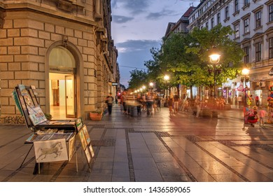 Belgrade, Serbia - September 9, 2016 - Night scene along the pedestrian street Knez Mihailova in downtown Belgrade, Serbia at sunset. Street artists expose their work or perform along the street.