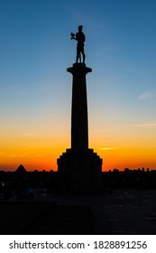 Belgrade, Serbia-August 27, 2020: Silhouette of Victor monument (serbian: Pobednik), symbol of Belgrade, with beautiful sunset sky in the background,at Belgrade fortress Kalemegdan in Belgrade, Serbia