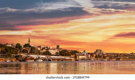 Belgrade Sunset Panorama with Tourist Nautical Port and Downtown Skyline, Viewed from Sava River Perspective.