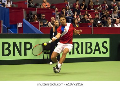BELGRADE-APRIL 9:Player D.Lajovic(SRB)return a ball during a match against Jaume MUNAR(ESP) during Quarterfinalsl Davis Cup Serbia-Espania.D.Lajovic won 2:1,on April 9,2017 in Belgrade,Serbia