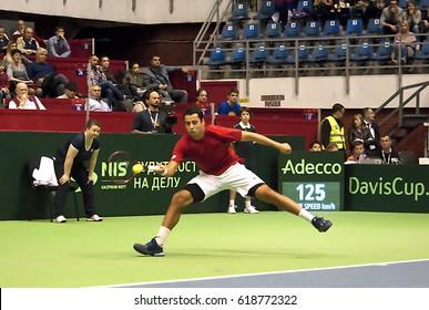 BELGRADE-APRIL 9:PlayerJaume MUNAR(ESP)return a ball during a match against D.Lajovic(SRB) during Quarterfinalsl Davis Cup Serbia-Espania.D.Lajovic won 2:1,on April 9,2017 in Belgrade,Serbia
