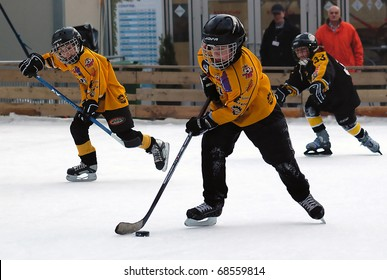 BELGRADE-JANUARY 8:Unidentified ice hockey players in action with puck at New Year's ice hockey tournament for children aged eight years on January 8, 2011 in BELGRADE,SERBIA