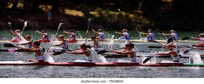 "BELGRADE-JUNE 19,""European Senior Canoe Sprint Championship"". Belarus four-seat kayak team who won in finale race K-4 500 m for women with time 00:45.990.June 19,2011 in Belgrade,Serbia"