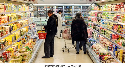 BELGRADE,SERBIA - CIRCA NOVEMBER 2009: Unidentified customer buys food in supermarket, circa November 2009 in Belgrade