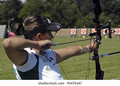 "BELGRADE,SERBIA - JULY 10: An unidentified female archer is ready to participate in the compound bow competition of the ""25th University Games"" on July 10, 2009 in Belgrade, Serbia"