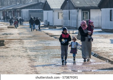 Belgrade,Serbia-January 31, 2017:Syrian Mother with three children in one of the Asylum Centers near Belgrade. In the interim detention centers for refugees currently located around 2,500 children.