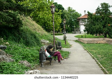 Belgrade,Serbia-July 10,2018.Lonely woman is reading a book at a park.