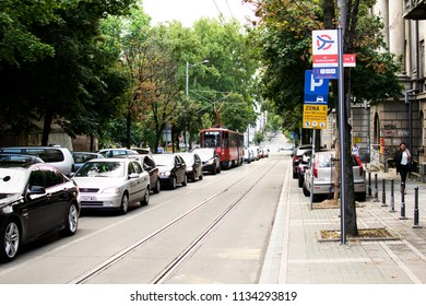 Belgrade,Serbia-July 12,2018.Image shows a street of the city with cars and tram at traffic.