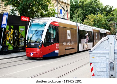 Belgrade,Serbia-July 12,2018.Image shows a tram crossing a street of the city.