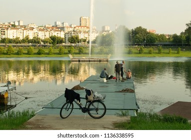 Belgrade,Serbia-July 9,2018.People fishing from a platform at the Ada lake.