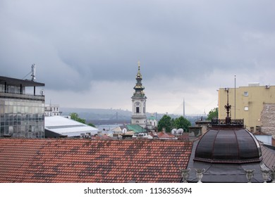 Belgrade,Serbia-July 9,2018.View from the roof of a building at the city.A church's cross at the horizon.