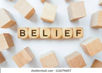 Belief word on wooden cubes