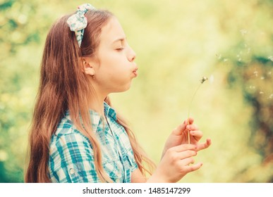Beliefs about dandelion. Girl making wish and blowing dandelion nature background. Why people wish on dandelions. Celebrating summer. Dreams come true. Dandelion full symbolism. Summertime fun.