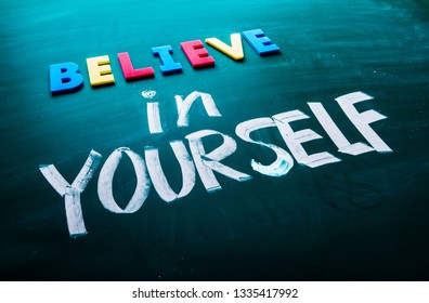 Believe in yourself concept. Colorful and handwriting words on blackboard.