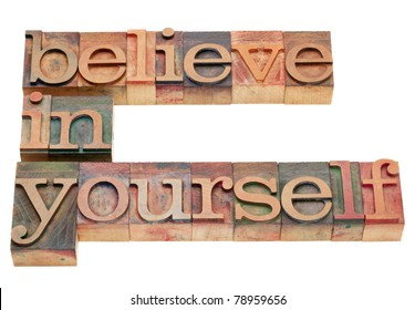 believe in yourself - motivation concept - isolated text in vintage wood letterpress printing blocks