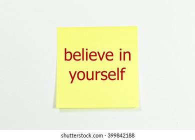 believe in yourself word written on yellow sticky notes.
