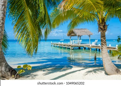 Belize Cayes - Pier on small tropical island at Barrier Reef with paradise beach - known for diving, snorkeling and relaxing vacations - Caribbean Sea, Belize, Central America