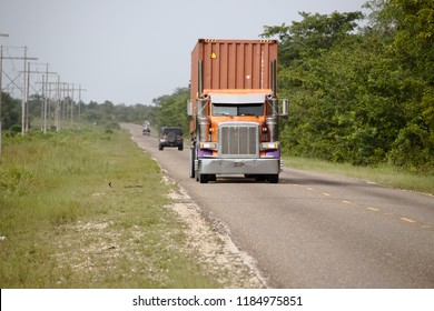 Belize City, Belize -August 8 2018: A Peterbilt Semi tractor transport a shipping container.