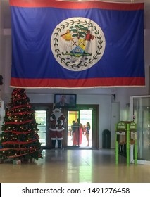 Belize City - Dic 2015 The flag of Belize was adopted on 21 September 1981, the day Belize became independent. It consists of the Coat of Arms on a blue field with red stripes at the top and bottom