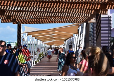 Belize City, Belize - March 2017: People walking down the boardwalk at the cruise port in Belize City, Belize.