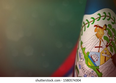 Belize hanging flag for honour of veterans day or memorial day on light blue dark velvet background. Belize glory to the heroes of war concept.