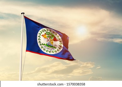 Belize national flag cloth fabric waving on the sky with beautiful sun light - Image