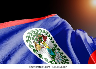 Belize national flag cloth fabric waving on beautiful sky.