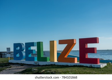 BELIZE - NOVEMBER 17, 2017: Colorful Belize name with Caribbean Sea in Background