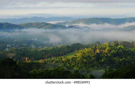BELIZE - OCTOBER, 2016 - SAN IGNACIO LANDSCAPE:  Early morning fog in the rolling hills of San Ignacio, Belize.