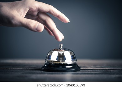 Bell and businessman's hand