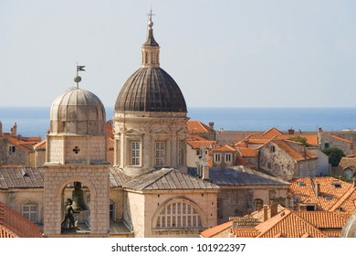 The bell of the City Clock Tower and the dome of the Assumption Cathedral of Dubrovnik, Croatia.