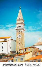 Bell clock tower and colorful facades at Tartini square in Piran, Istria, Slovenia.