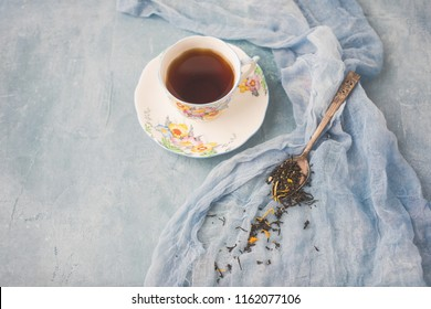 Bell Fine Bone China 3388 on Blue Background with Spoon of Ginger Peach Herbal Tea Beside