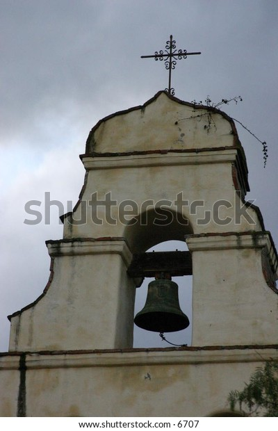 bell hanging high in church structure